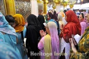 A Woman Raises Her Hands in Prayers at Hazrat Nizamuddin Dargah